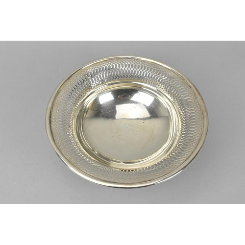 81 - A George V silver pedestal bowl by Barker Brothers, Chester 1915, with pierced everted rim, raised o...