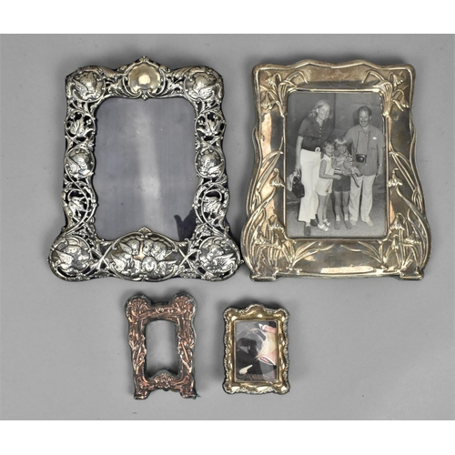 12 - An Edward VII silver frame by William Comyns, London 1901, in the Art Nouveau style with pierced fol...