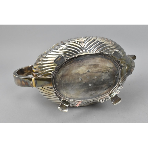 60 - A George III silver tea pot and sugar bowl by Joseph Angell I, London 1816, designed with part flute...