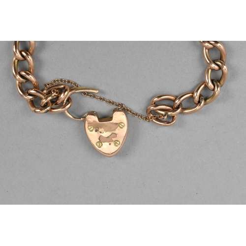 53A - A 9ct rose gold curb link bracelet inset with turquoise and pearls, with heart locket and safety cha...