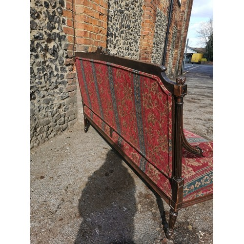 104 - A Victorian upholstered carved walnut sofa, the centre of the back frame with carved scroll flanked ...