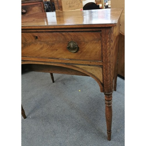 122 - A Georgian mahogany lowboy writing table, with twin handle frieze drawer with lion mask half hoop ha...