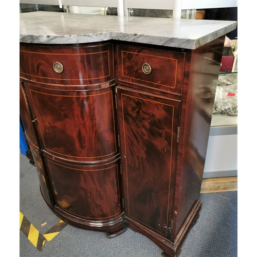 125 - An Edwardian string inlay flame mahogany sideboard with shaped grey marble top, the bow fronted cent...
