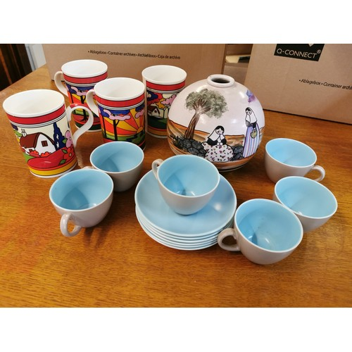 61 - A set of six Poole Pottery coffee cups and saucers, together with a painted pottery vase of globular...