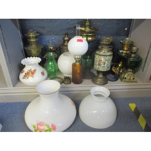 112 - A collection of 20th century oil lamps A/F with various glass funnels, reservoirs and shades  Locati...