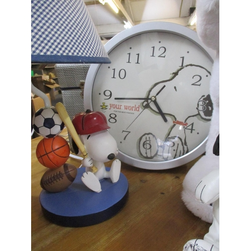 136 - A pair of 2011 composition table lamps, 46cm high, in the form of Snoopy holding a baseball bat next...