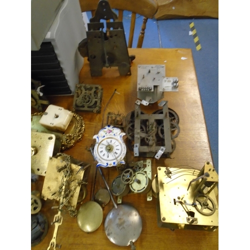 4 - A selection of clock movements and other parts, to include chronometer dials signed Frosham, Ulysse ...