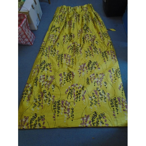 76 - A single curtain double pleated and lined, decorated with a floral pattern in the Japonesque style a...