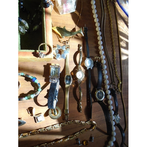 77 - A quantity of costume jewellery to include dress watches, beaded necklaces, brooches and rings, in a...