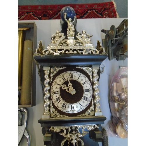 92 - A Dutch Zaanse wall clock with chains for two weights and a selection of clock parts Location: LAF...