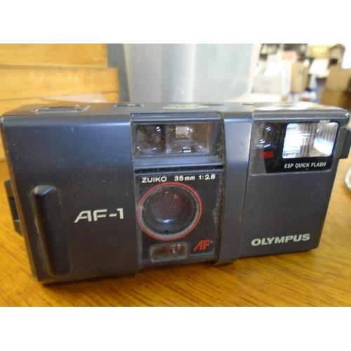 93 - A Kowa SE Japanese film camera, with Kowa 1:1.9 f=50mm lens serial No.587387, an Olympus AF1 camera,...