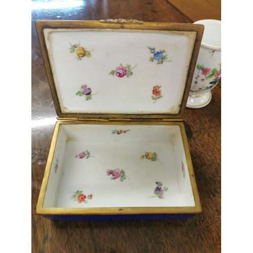 106 - A French late 19th century hand painted porcelain jewellery box, with central floral spray to lid, t...