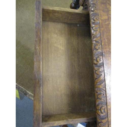 1 - Circa 1880, a Victorian baronial carved side table with apron drawer, scrolled swags, turned candy t...