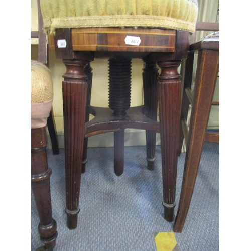 100 - An adjustable piano stool with rosewood top having a later tapestry cover above reeded mahogany legs...