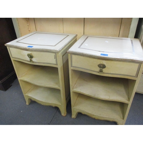 102 - A pair of cream painted Continental pine bedside chests with single drawer and shelves, in cream wit...