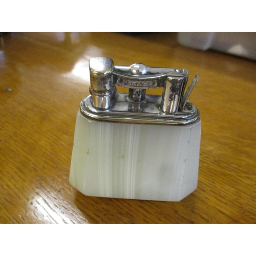 104 - An Onyx Ronson table lighter, a Dunhill lighter A/F and a Copenhagen trinket dish Location: Porters...
