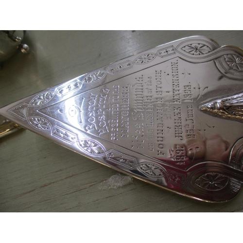 11 - A small quantity of miscellaneous silver ware to include a Boston Harbour commemorative dagger, a ca...