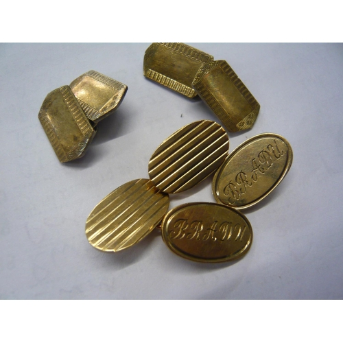 114 - A pair of 9ct gold cuff links, 8.7g and a pair of silver gilt cufflinks, (total weight 16.7g) Locati...