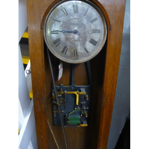 121 - Two oak Synchronome master clock cases each with a movement, dial and pendulum, 127cm high and 129cm...