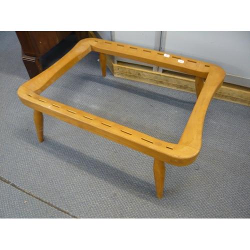 131 - An Ercol Windsor light beech footstool, no webbing on turned legs Location: C...