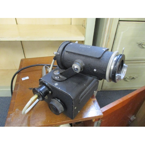 132 - A vintage W. Watson and Sons 'Bactil' binocular microscope, with carry case, together with a Watson ...