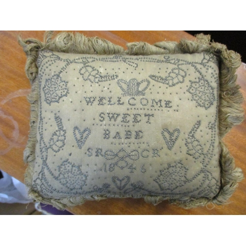 137 - A Victorian embroidered silk pillow ' Welcome Home Sweet Baby' dated 1846 together with a Stuart Cry...