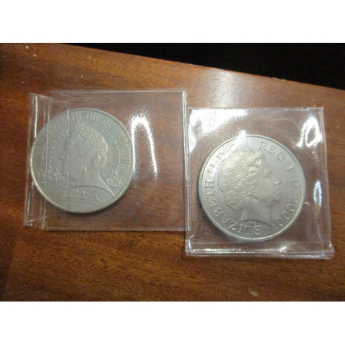 138 - A collection of coins to include two five pound coins and mainly pennies and shillings together with...