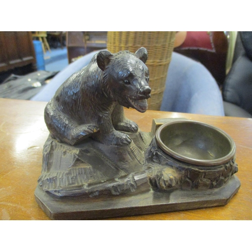 139 - A Black Forest carved inkwell, with bear perched on a tree trunk together with two Prattware pot lid...