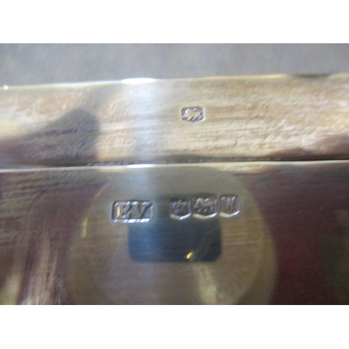 141 - Two silver cased cigarette boxes, one engine turned, A/F Condition: marks rubbed out on smaller box ...