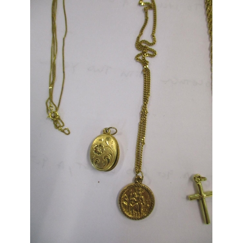 16 - Five 9ct gold chains together with a 9ct gold locket, a 9ct gold cross and a pair of 12ct gold cuff ...