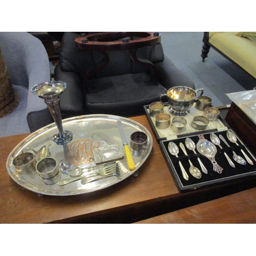 19 - A collection of silver to include a sugar bowl, six napkin rings and a cased set of six teaspoons wi...