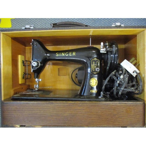 24 - A Singer 99k electric sewing machine, circa 1950's Location: LAM...