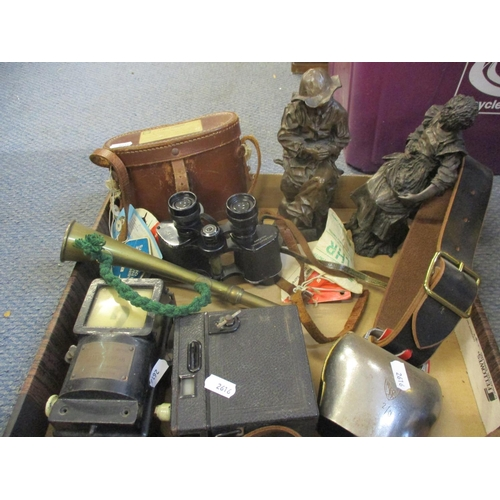 25 - A pair of International military binoculars, vintage camera, a cow bell, a boy scout belt, horse lea...