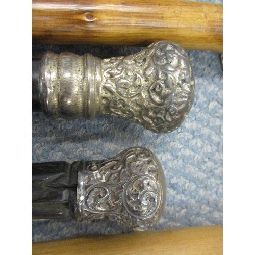 28 - A silver topped walking cane, a silver plated topped walking cane and eight others, together with a ...