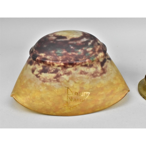 31 - An early 20th century Daum glass mushroom lamp, the mottled red and yellow domed shade with lobbed s...