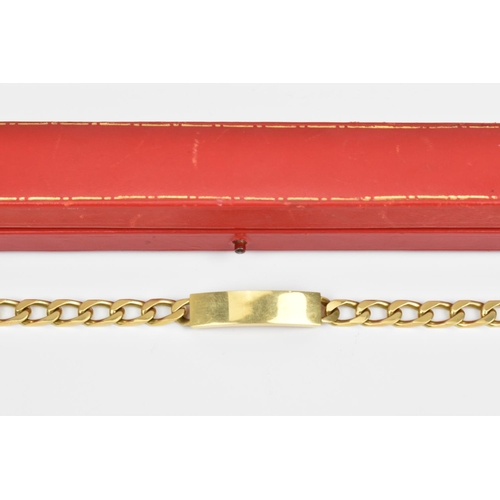 34 - An 18ct gold Cartier flat curb link identity bracelet, with central name plate and box clasp, in ori...
