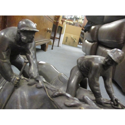 36 - A bronze figural group on stepped marble base of two jockeys on racehorses galloping signed E...L......