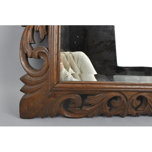 37 - A turn of the century Continental carved oak cushion mirror, circa 1900, possibly Flemish, of rectan...