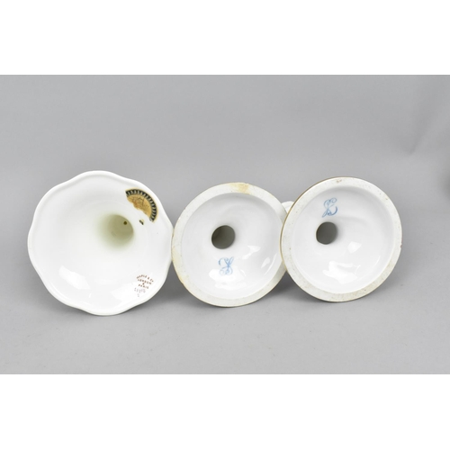 38 - A small collection of German porcelain to include a pair of candlesticks, a Dresden bowl with hand p...