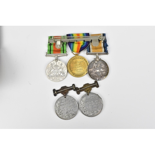 40 - A WWI and II three-medal campaign group named to M2-079784 Pte J W Barnes ASC, comprising Victory an...