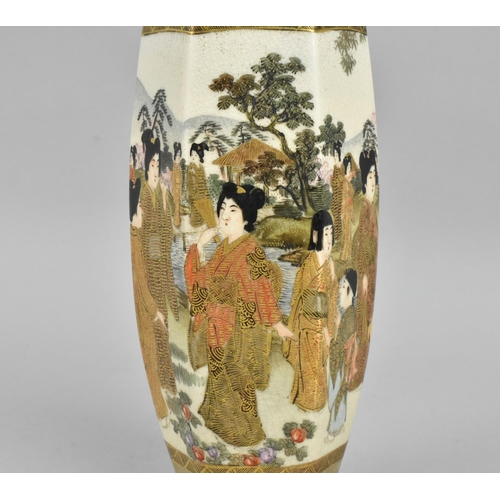 43 - A Japanese Meiji period Satsuma earthenware vase, of slender hexagonal form painted with geishas in ...