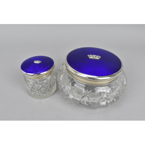 46 - An early 20th century silver and enamel mounted matched dressing table set, comprising a hand mirror...