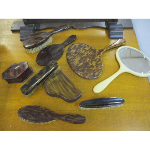 53 - A mid 20th century oak dressing table mirror, together with tortoiseshell boxes, mirrors and brushes...