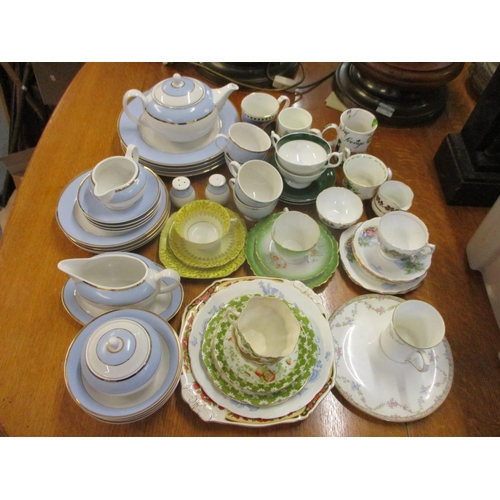 58 - A Doulton tea service, four dinner plates and salt and pepper shakers, together with mixed teacups a...