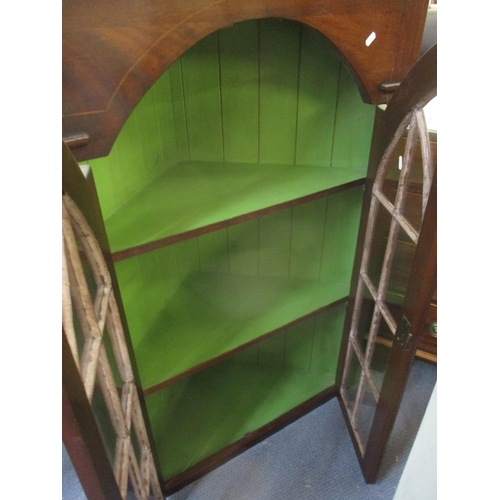 6 - A George III corner cabinet, stepped, moulded cornice, twin glazed doors, above fielded panels with ...