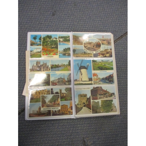 60 - A mixed lot to include postcards, stamps, an alarm clock, tins and other items  Location: 2:5...