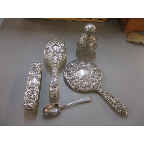 67 - A matched silver dressing table set, together with a silver spoon  Location: 5:2...