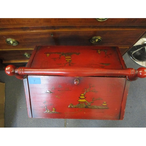 7 - Circa 1900, a red lacquered chinoiserie sewing companion with hinged top, turned vase shaped formed ...