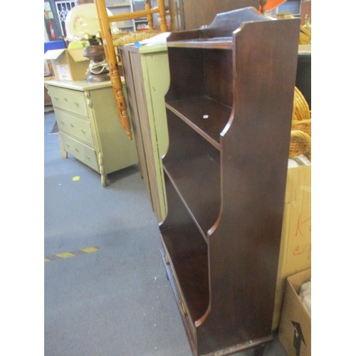 96 - A reproduction mahogany waterfall bookcase with single drawer below 112cm h x 57cm w x 15cm d Locati...