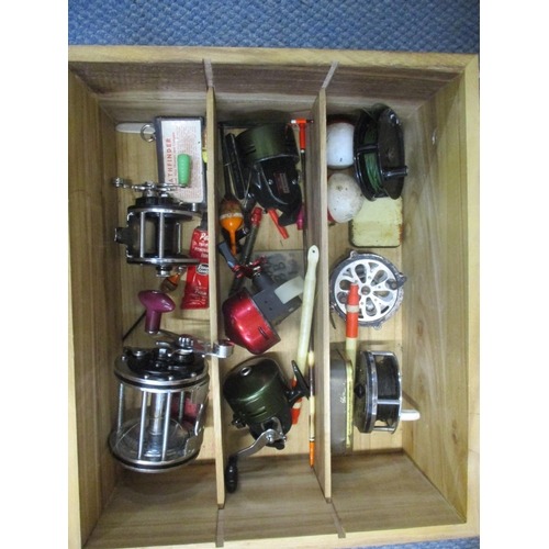 78 - A box containing various fishing reels, floats and other fishing accessories to include an Olympic 4...